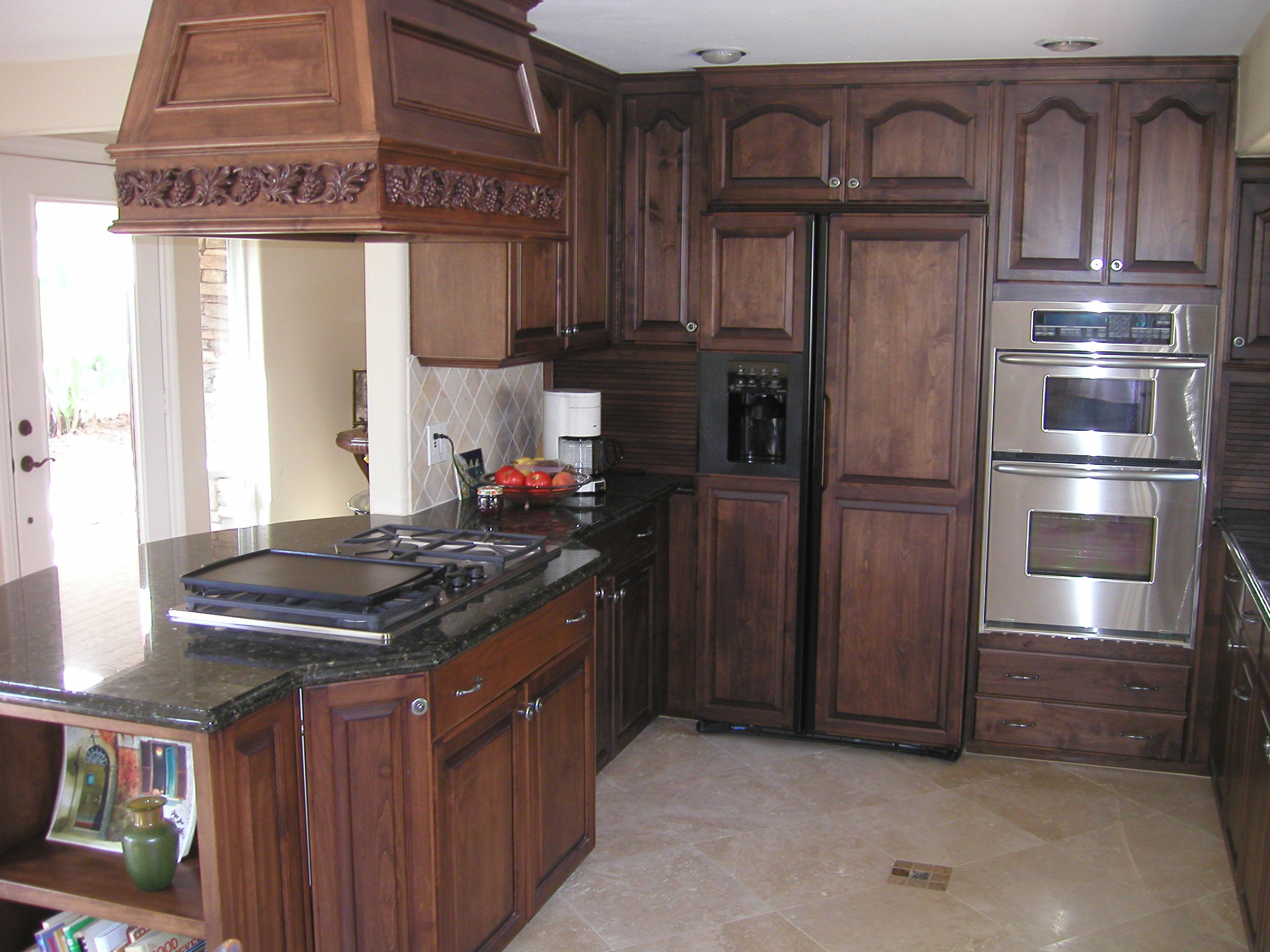 New SoCal Creative Woodworks kitchen cabinets Stained dark oak and